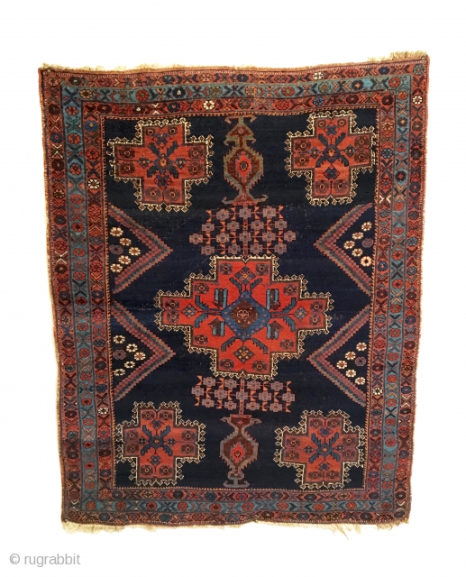 Antique Afshar Rug. Late 19th Century. Stylized multi-colored vases rest on top and bottom with central striking medallion. Truly a tribal piece. All original in very good condition. Remnants of kilim ends  ...