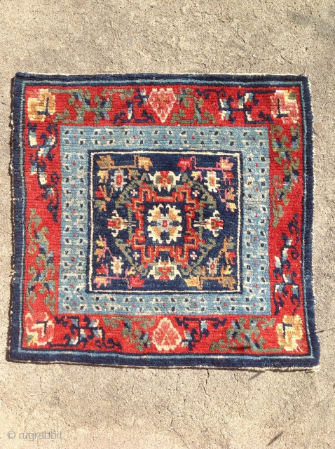 Small sitting carpet with great colour. The slightly crowded field is nicely complimented by the a light indigo Barley grain inner border. Beautifully drawn floral spandrels finish the outer border. Pile is  ...