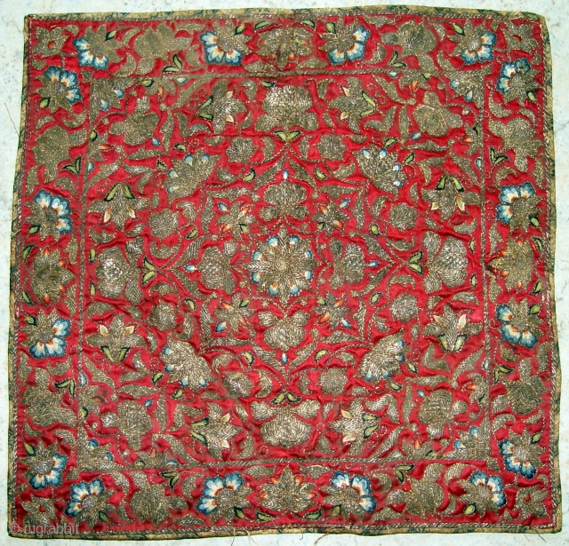 An Antique Persian silk embroidery 18th century with silk on silk and metal thread.    It's size is 36 x 35 cm.