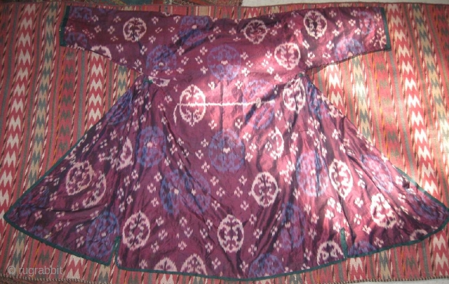 Antique Uzbek ikat coat. In excellent condition, without damaged area, dirty places, only two small holes.