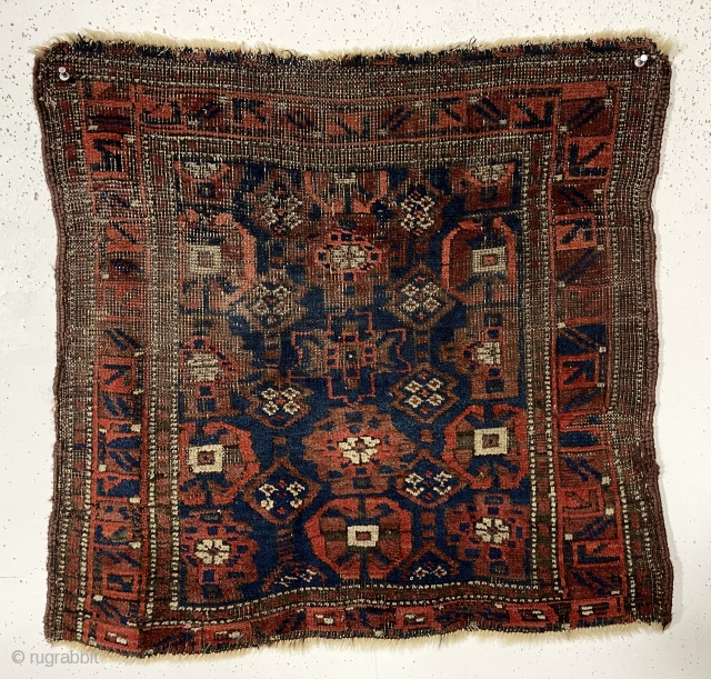 """Antique Baluch bagface. Interesting Mina Hani variant. Good natural colors with fine ember reds. Areas of heavy wear as shown. Original selvages. As found, very dirty. 19th c. 24"""" x 26"""""""