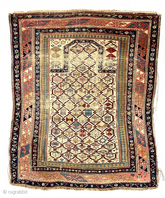 Early ivory ground shirvan prayer rug with unusual elements and extremely saturated natural colors. Some lattice elements are unusual if not unique. Unfortunately the rug is in very rough condition with areas  ...