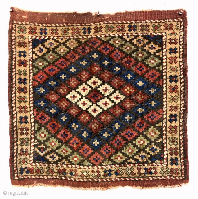 Early small Anatolian rug in good condition. Unusual diminutive size and uncommon design. West Anatolian? Bergama? Overall low even pile. Original end flat weave and fancy selvages. All natural colors featuring pretty  ...