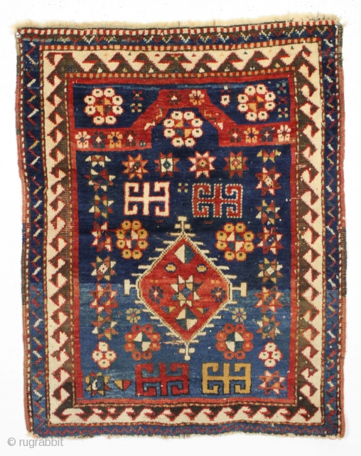 All original diminutive kazak prayer rug.