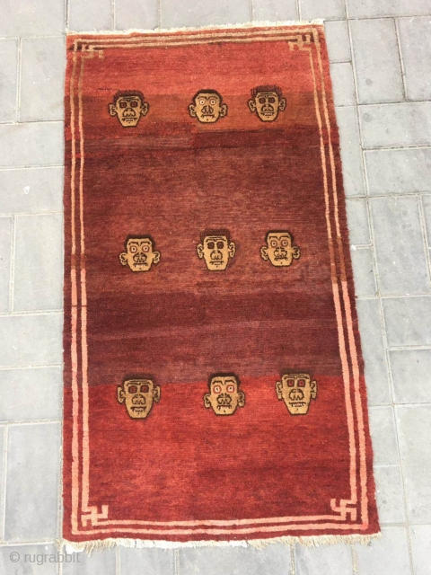 Tibetan rug, red  background with skeleton head veins. Size 152*80cm.