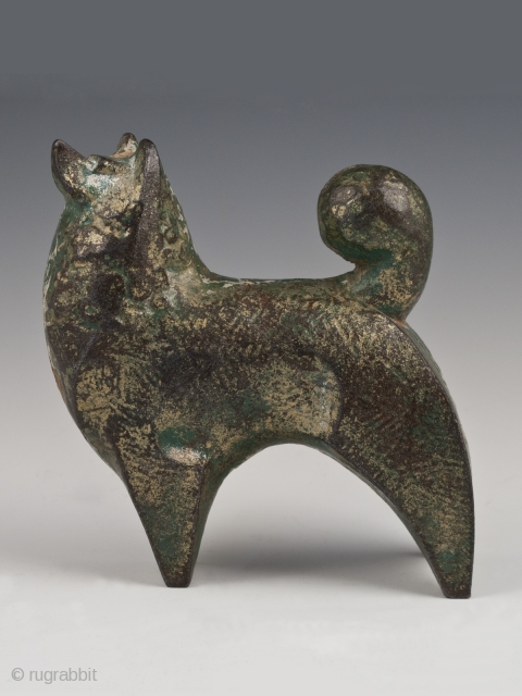 """Akita okimono, Japan. Cast iron, remnants of gilding or green and gold paint. Mid 20th century. 5 """" (12.7 cm) high by 4.75"""" (12 cm) wide.  Last year, a small group of cast iron animals was  ..."""