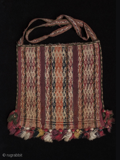 """Chuspa (coca bag), Department of Potosi, Bolivar Region, Bolivia. Wool, natural dyes, Late 19th century, 9.5"""" (24 cm) high by 8.5"""" (21.5 cm) wide  Plain weave coca bag, with double-faced weave pattern bands using complementary warp sets."""