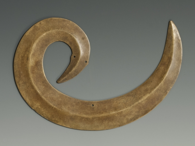 """Sanggori head ornament, Toraja people, South Sulawesi Island. Brass/copper alloy, 5"""" (12.7 cm) high by 7.25"""" (18.4 cm) wide, early 20th century. This sanggori is convex on both sides at the ridgeline. See photo  ..."""