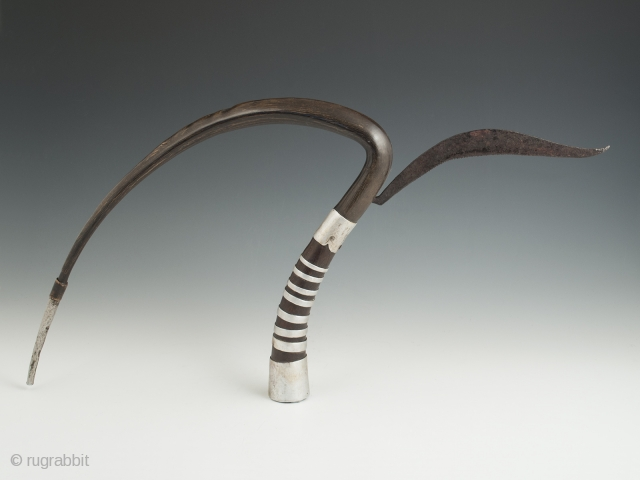 """Rice cutter, Khymer culture, Cambodia. Horn, aluminum, iron, 10.5"""" (26.6 cm) high, 22"""" (56 cm) wide. Mid-20th century. The gracefully curved part of the ox horn was used to gather a handful  ..."""