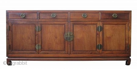 Mid Century Chinese Buffet Console Chest or Cabinet Hauli Wood  A mid century Chinese Buffet or Console Chest or cabinet made entirely of Chinese Hauli wood. Two double hinged doors open to a  ...