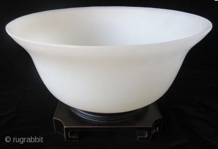 Antique Chinese Monochrome Peking Glass Bowl   Chinese large monochrome peking glass bowl in a pale green color similar to jadeite. The rim flares out slightly from the flattened circular body, and stands on  ...