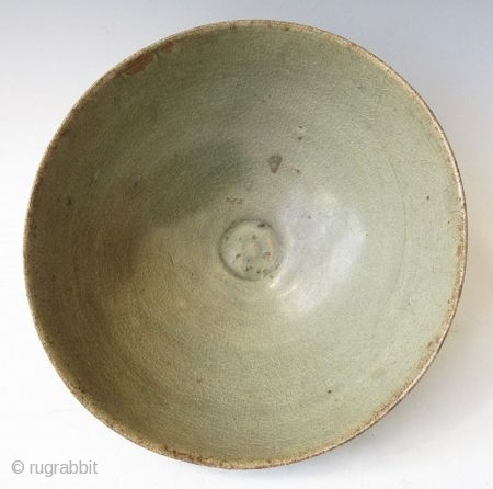 Antique Korean Koryo Celadon Bowl  Antique Korean Koryo bowl with celadon glaze and crackling, the small recessed well with carved outline, the exterior body of the bowl carved with repeating lotus petals, and  ...