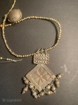 Exquisite antique silver necklace, circa 19th century. Each tiny bead is hand folded into a geometrical shape. I doubt if this kind of craftsmanship can be done today. The hexagonal pendant opens  ...