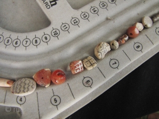 Etched Carnelian Beads: Loose strand lot of mixed etched and faceted beads from what is now Pakistan. I bought these along with a group of Bactrian and Kushan coins so these come  ...