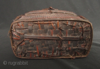 Rare pair of old lidded baskets from the Rawang ethnic group from Northern Burma circa 40 to 50 years old. The small basket is H: 12.3cm/4.8in, W: 6.3cm/2.5in and L: 13.2cm/5.2in. The  ...