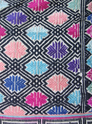 Lovely wedding blanket from the Antai Miao, Rongshui County, Guizhou. This piece is in perfect condition, circa second half 20th CE, made from all handspun undyed or indigo threads, except for the  ...