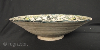 Nishapur Bowl: Large early Islamic Central Asian, Persian polychrome pottery bowl decorated with lively composition of animals - Circa 9/10th CE. Large repair (noted in last enlargements) and typical fritting. The red  ...