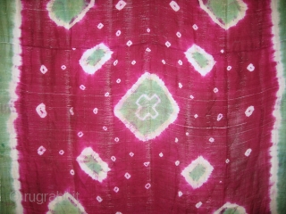 An gorgeous antique Uzbek tie-dyed silk panel. This beautiful textile dates to around 1900 (possibly earlier). These textiles were used as a scarf and unlike Ikat fabrics, they were dyed after being  ...