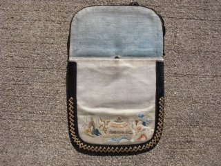 """Antique Chinese silk purse, China ca. 1920, hand embroidered on beige silk, a combination of feather stitch, brick stitch, and """"forbidden stitch"""", three pockets, one on each side, worn with some missing  ..."""
