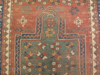 Antique Caucasian Kazak rug in a one way prayer rug design, Fachralo or Borchalo distric, ( Borchalu ), 19thC, hand knotted wool on a wool foundation, Caucasus Mountains, an unusual green field  ...