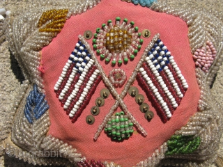 Antique Iroquois 6 lobed bead work pillow / pincushion, piled on glass beads sewn on red cloth with 2 flags, most of the similar examples in the Smithsonian are attributed to the  ...