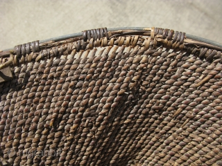Antique Apache burden basket, Native American,19thC, hand woven, hand twined with willow, black devil's claw, the redish-brown seen on the inside but faded on the outside, is probably yucca root, the rim  ...
