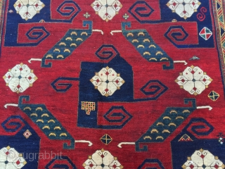 Antique pinwheel kazak ca 1900 large size 8 ft 11 X 6 ft 4 I.   Original ends and sides pole medium to low with some scattered old repairs. The red has a  ...