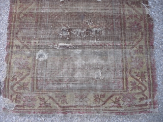 Ancient ethereal Khotan rug with an unusual design, complete and in ghostly condition.