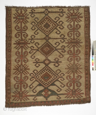 Kyrgyz eshik tysh (tent door covering), 1850's, Central Asia, Alay mountains, 130 by 111 cm, an early and rare white type, low pile, stain to upper diamond, small reweaves, otherwise in a  ...