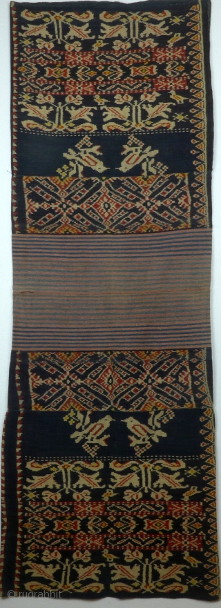 Traditional tubular women's skirt, sarong, Roti, Indonesia, second half 20th century Handwoven traditional ikat, hand spun cotton yarn, natural dyes, 4 parts, center part in two colored stripes, floral and geometric motifs, main  ...