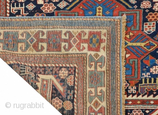 """Antique Shirvan """"Akstafa"""" bird/peacocks rug, ~1870. Size: 117x260cm (3'10""""x8'6""""). The dark blue indigo field with three blue, ivory and red octagonal star medallions, each containing different motifs such as hooked swastika, diamond  ..."""