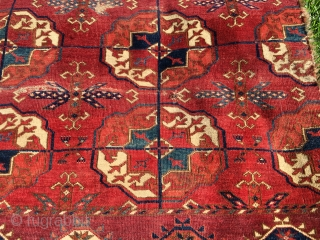 "Early Tekke main carpet fragment. 2'6""x 2'7"". very soft handle."