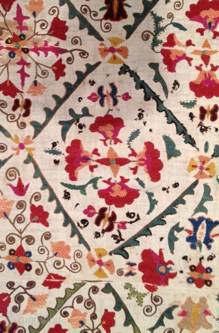 """Very pretty early 19th century Suzani with wonderful colors. Has stains but in decent condition otherwise. 4'9"""" x 3'2'."""