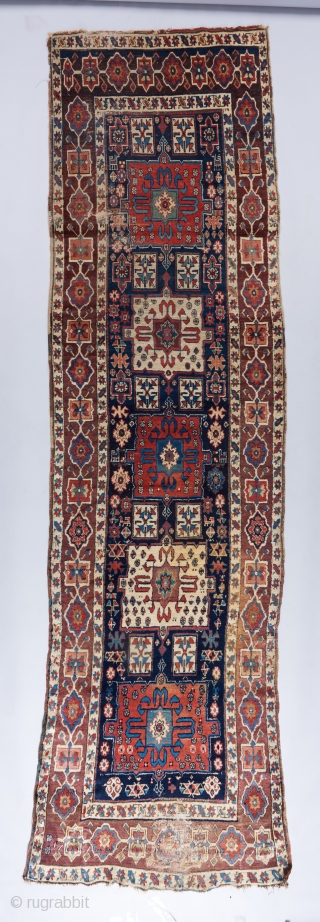 """A beautiful Shahsavan runner with great age. 12'4"""". x 3''6"""". A dog stain towards the lower right and some heavier wear towards the bottom. Mostly in great pile."""