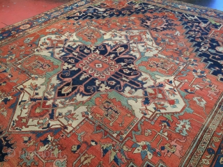 Antique Heriz Serapi with a very special ivory medallion. 1910 or earlier. Size 12ft x 16ft. Remarkable color and powerful drawing. Supple handle and soft wool. Good condition and floor ready. Lots  ...