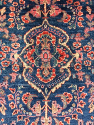 Antique Persian Sarouk rug c.1920. Size: 2'1 x 3'11. Lovely colors with a beautiful blue jeans background, fine weave, perfect condition. Please contact me for more photos/information. Thank you.