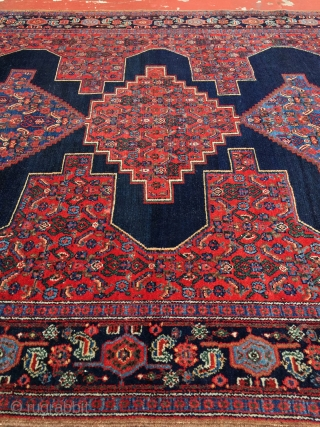 """Antique Senneh rug with a crisp classic design and the most saturated dyes you could ask for. Size: 4'6"""" x 6'5"""". Good pile with lower in the center. Excellent example ready to  ..."""