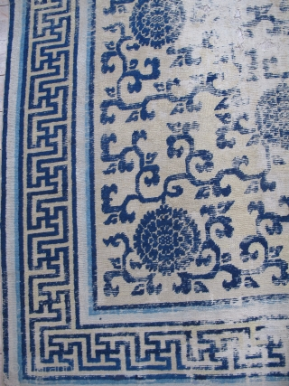 Classic Chinese Ningxia Carpet with vine-scroll and peonies field. Likely Kangxi period, large, smashed, with rips, tears, and several generations of repiling. Still majestic. About 8'x10'
