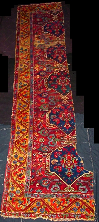 """Exceptional multi-medallion long Demerci Kula Fragment (about 65% of the original rug) circa 1776.  Inscribed multiple times with """"mashallah"""".  Very soft pile and supple handle with the best saturated colors found in  ..."""
