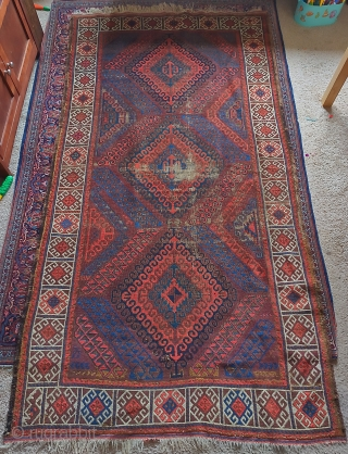 """Symmetrically knotted Baluch rug with a Mushwani type diamond design. Some wear and old attempts at restoration. Dynamic and fun with nice natural color. 3'8""""x6'10"""""""