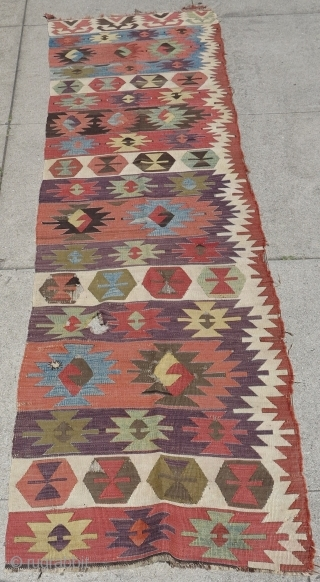 """Central Anatolian kilim with ashik-like devices and great movement. Very nice colors, aubergine! speckled blues and greens (no sulphonics). Good age, size is 28"""" x 115"""""""