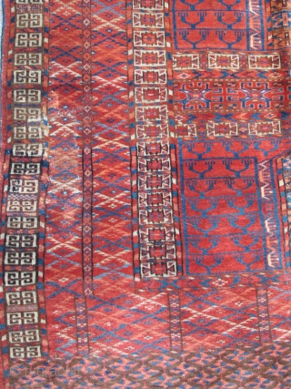 Tekke Ensi, some silk highlights, interesting sainak formation, area of repair in bottom left border. Flashy color including a light blue and insect red. Velvety pile.