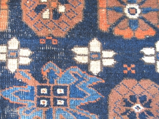 Khorossan Baluch Minakhani Rug with Open Blossoms. This is an uncommon variant seen most frequently on earlier minakhani Baluch carpets. This piece was woven with depressed warps, natural colors including aubergine and  ...