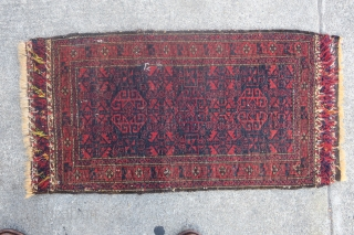 Baluch balisht with radiant reds and glossy wool. Silk highlights in the flatwoven ends. Cochineal used as abrash in the central geometric ornament.