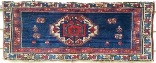 """Veramin - about 13"""" x 31"""".  Beautiful color, shiny wool, fine weave.  Missing secondary, scattered old repairs, moth damaged."""