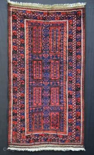 "Fabulous indigo-blue, full-pile, glossy wool Timuri rug in excellent condition and complete with brocaded skirts circa 1890-1900. 1.98m x 1.10m (6' 6"" x 3' 7"")."