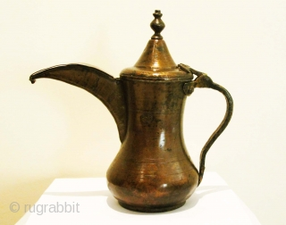 Brass Dallah. Syria, Circa 1900. H = 20 cms    A rather interesting coffee pot. This is the first dallah we have acquired/seen with a Greek Orthodox (or possibly Assyrian) maker's seal. The  ...