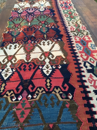 "Antique Malatya kilim strip. Size is cm 75x395 or 2'8""x11'2"" ca. Age is first quarter 19th century. Colors are simply wonderful: indigo, green, madder, cochineal, aubergine, etc....all fantastic. Some brown must have  ..."