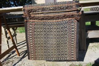 Qashqai Dareshuri tribe warp-faced saddle bag/khorjin. Cm 62x112. Late 19th or early 20th century. Cords in perfect condition. Open on sides. Some old, small repairs. Charming, collector's piece. See more pics on  ...
