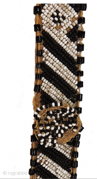Kuba people beaded headband - Congo. Mid 20th century or earlier. Cm 73x3 ca. Raffia, cowry shells, beads. Such headbands were worn by nobles of Kuba royal families. They were the sign of  ...